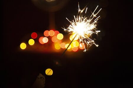 Bengal fire and sparks macro photo festive bokeh background Christmas and New Year Reklamní fotografie - 135508389