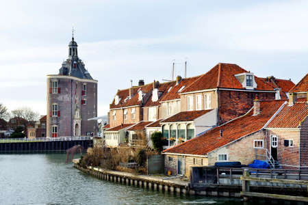 Beautiful view on castle and old houses near the river in Enkhuizen city of Netherlands background