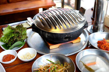 Korean traditional cuisine: meat on fire roaster