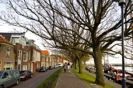 Street of traditional old buildings along the pier somewhere in Netherlands