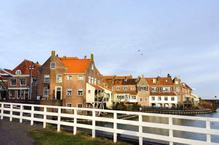 View from the bridge in Enkhuizen city in Netherlands traditional old brick buildings with tile roofs Stock Photo