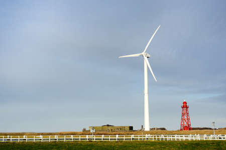 Wind turbine and lighthouse background with free space