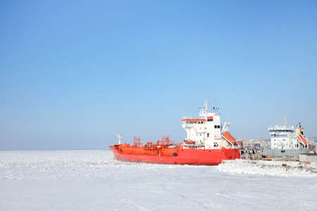 Red expedition ship in the ice Stock Photo
