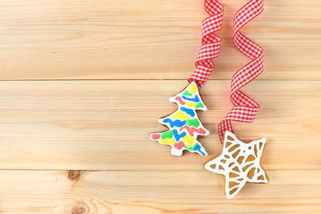 Christmas cookies with festive decoration on wooden background. Free copy space.