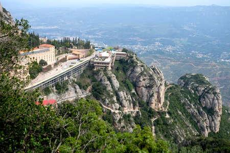 Santa Maria de Montserrat Abbey in Monistrol de Montserrat Monastery view from above located nearby from Barcelona in Catalonia, Spain 写真素材