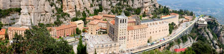 Santa Maria de Montserrat Abbey in Monistrol de Montserrat Monastery view from above located nearby from Barcelona in Catalonia, Spain. Panoramic view.