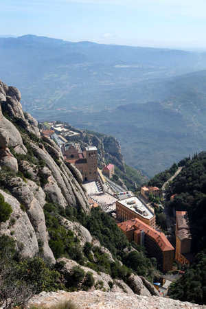 Santa Maria de Montserrat Abbey in Monistrol de Montserrat Monastery view from above located nearby from Barcelona in Catalonia, Spain Stock Photo