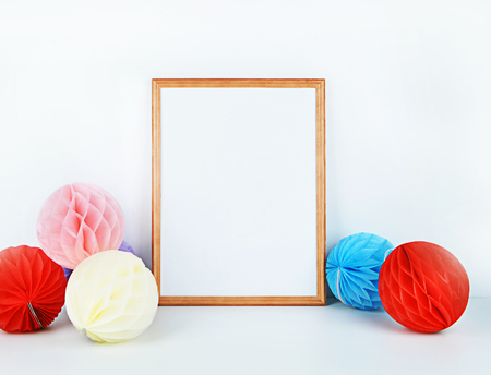 Wood picture frame with decorations. Mock up for your photo or text Place your work, print art. Paper balls colorful Stock Photo