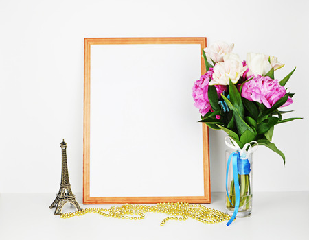 Wood picture frame with decorations. Mock up for your photo or text Place your work, print art. Peonies in vase. Stock Photo