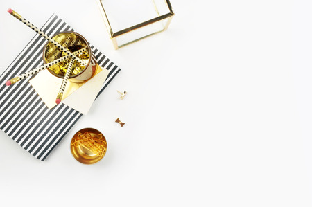 Header website or Hero website, view table gold accessories office items. Flat lay. Feminine workspace. Stock Photo