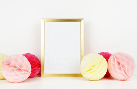 Golden frame mockup for your picture, party style. paper colorful balls. Poster template, Vintage style mockup Stock Photo