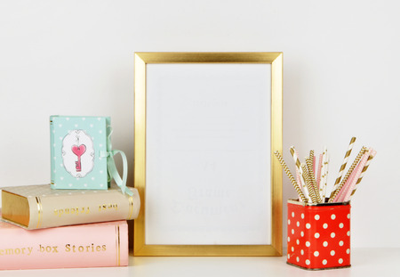 gold picture frame with decorations. Mock up for your photo or text Place your work, print art,shabby style, white Stock Photo