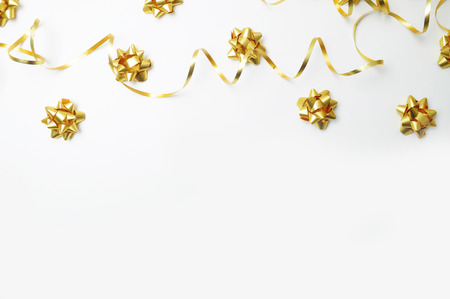 Top view. White background with gold decoration. Gold ribbon. Flat lay. Party mockup Stock Photo