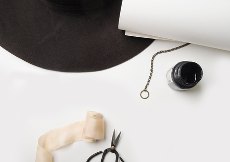 Modern white background. Hat, ink, white sheet. Creative place. Flat lay. Top view.  scissors bonsai Stock Photo