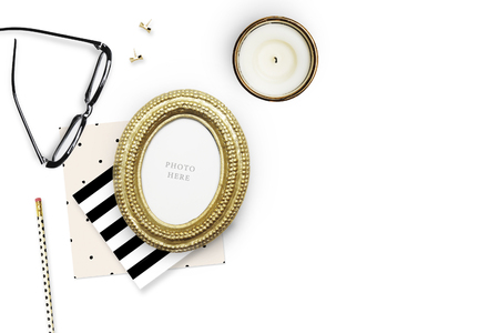 Gold Frame mock-up.Table view woman items, white background , woman desk. Flat lay. Still life