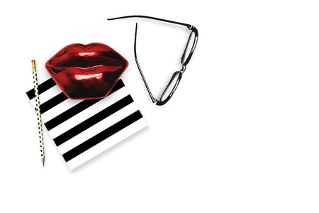 Flat lay.Table view woman items, white background mock up, woman desk. Still life. Red lips. Mock-up. Stock Photo