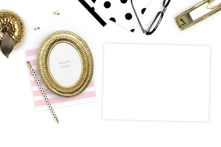 Table view woman items, white background mock up, woman desk. Flat lay. Still life. Gold Frame. Mock-up. Stock Photo