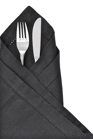 napkin: Knife and Fork wrapped in a black napkin as a table setting