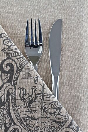 Knife and Fork on linen with French vintage design Stock Photo