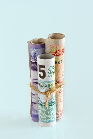 european money: British Pounds Bank Notes.  Money is tied up concept Stock Photo