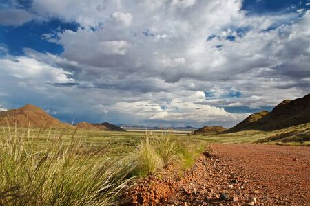 Storm clouds gathering over landscape of Namibia