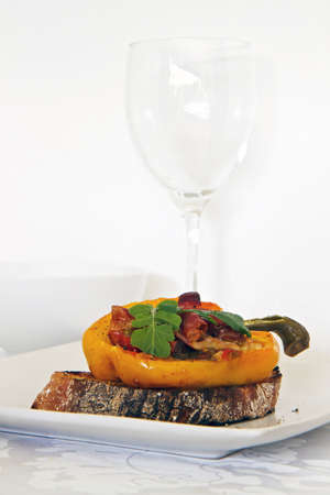 Roasted peppers with italian bread and wine glass Stock Photo