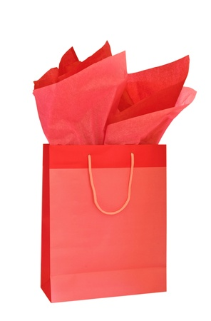 Red Christmas gift bag with tissue paper isolated on white background Standard-Bild