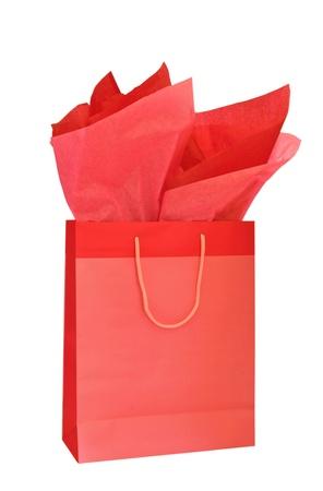 Red Christmas gift tas met papieren zakdoekje geïsoleerd op witte achtergrond Stockfoto