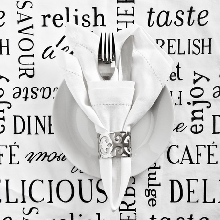 white napkin: Table place setting with  printed white linen