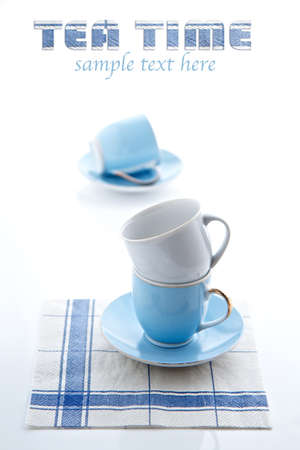 Tea Time - stacked tea cups and serviette photo