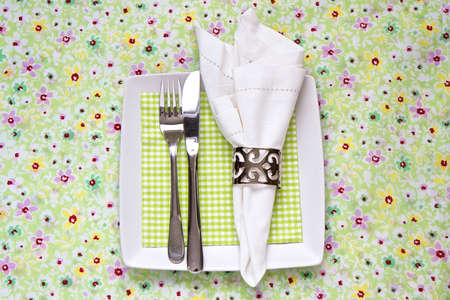 Table place setting for Spring with floral tablecloth photo