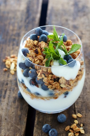 Natural yogurt with berries and muesli photo
