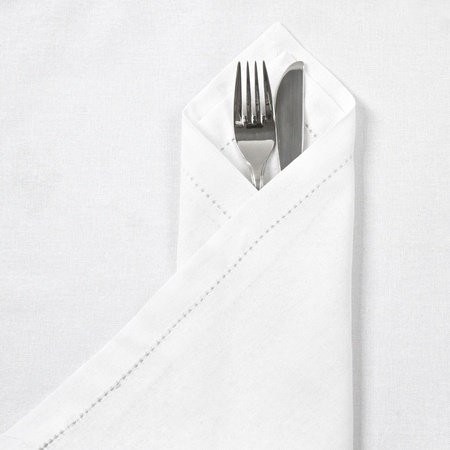 on the tablecloth: Knife and fork with linen serviette