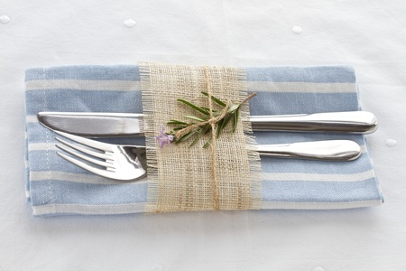 Knife and fork with napkin tied with string and natural hessian Standard-Bild
