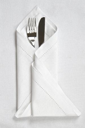 Mes en vork met linnen servet