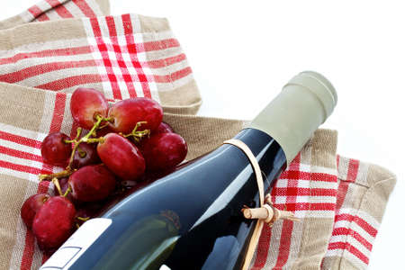 Red wine and grapes with napkin and space for text Stock Photo