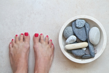 Feet and zen stones at a spa with space for text photo
