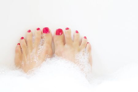 soaking: Feet soaking in spa bath with space for text