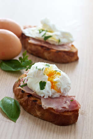 Poached egg and ham breakfast