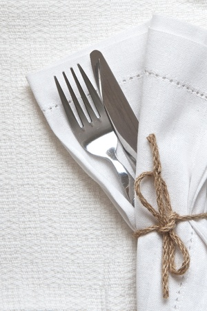 White linen napkin and cutlery