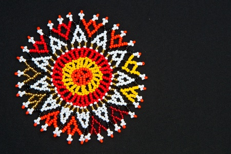 Beaded African design pattern with space for text