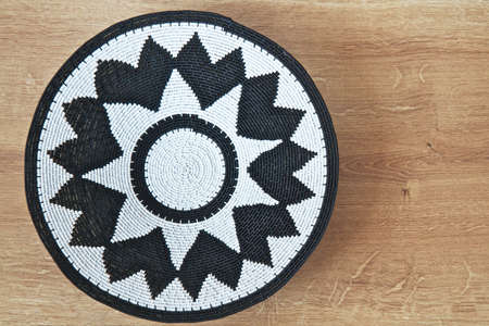 Decorative design made by African craftsmen with space for text