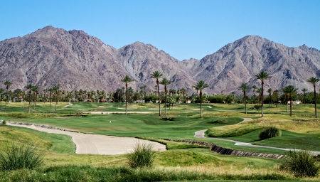 Golf course landscape with mountains photo