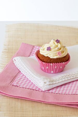 Cupcake with white icing and decorated photo