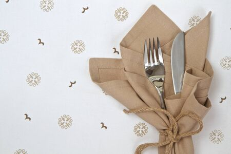 Natural linen napkin with knife and fork photo