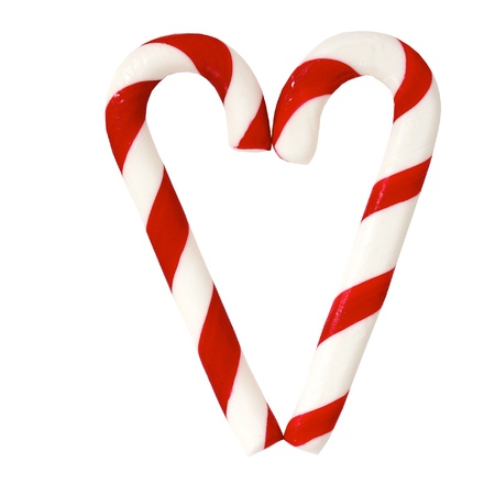 Christmas Sugar Candy Cones forming a heart and isolated on a white background Stock Photo
