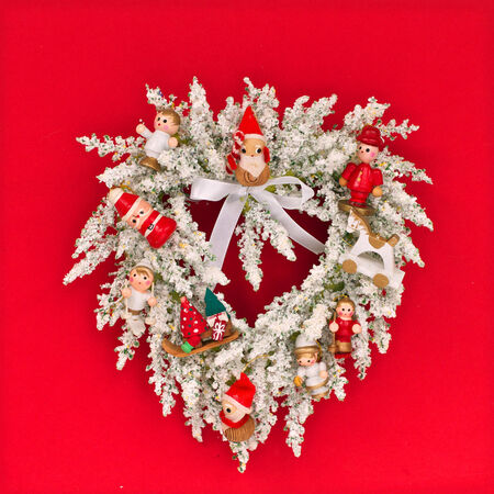 horse sleigh: White Christmas wreath with wooden decorations Stock Photo