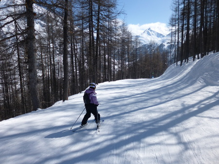 run down: Val dIsere, France - March 14, 2016: A winding ski run through the trees down to Val dIsere