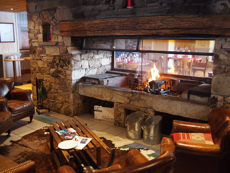 Cozy log fire in an Alpine ski chalet