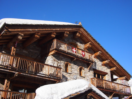 chalet: Traditional ski chalet covered in snow
